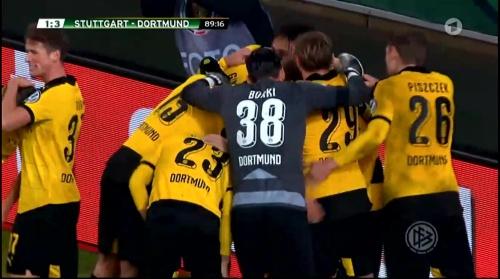 Dortmund players celebrate third goal - Stuttgart v Dortmund - DFB Pokal